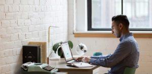 man coding at computer