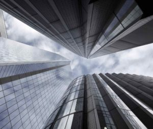 looking up at large buildings from the ground