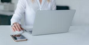 closeup woman working on laptop