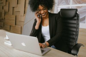woman on phone call while on laptop